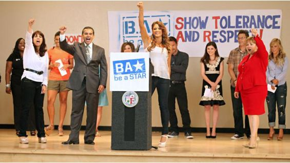 Eve and the mayor lead the group in taking the be a STAR pledge.