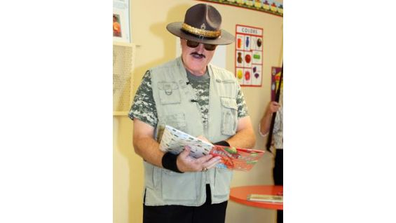 WWE Hall of Famer Sgt. Slaughter reads a story to the children at the Yerwood Center.