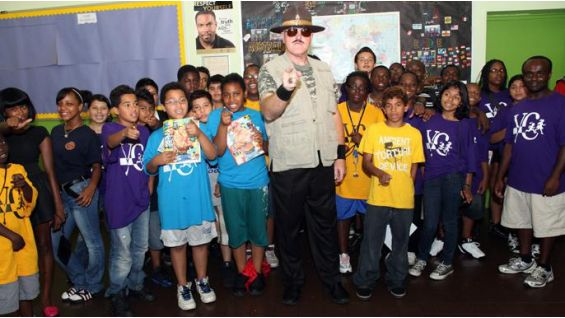 The WWE Legend visits two classes of kindergarteners during the Summer Reading Rally.