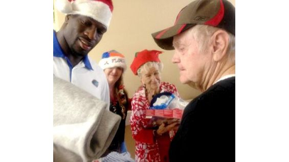 Titus O'Neil gives gifts to seniors in his home state, Florida, during the holidays.