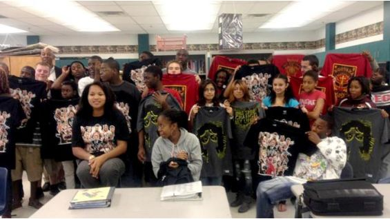 Kids from various organizations in the Tampa, Fla., show off their WWE gear courtesy of the NXT Rookie.