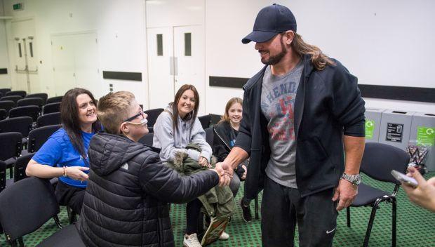 AJ Styles grants a wish for Kai in Brighton, England