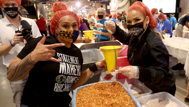 WWE Superstars take part in 9/11 Day meal pack in New York City: photos