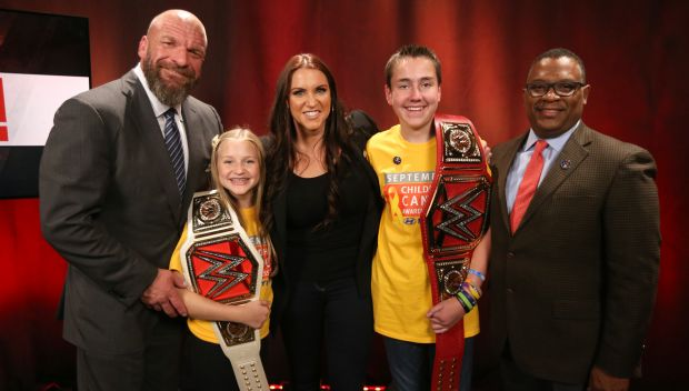 Stephanie McMahon and Triple H recognize childhood cancer survivors Carter and Elizabeth in partnership with Hyundai