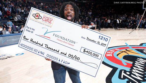 Xavier Woods represents Connor's Cure at the Jimmy V Classic: photos