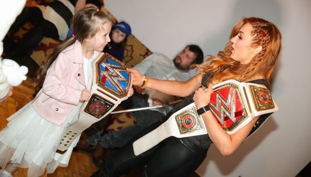 Becky Lynch & Seth Rollins grant wishes in the UK & France: photos