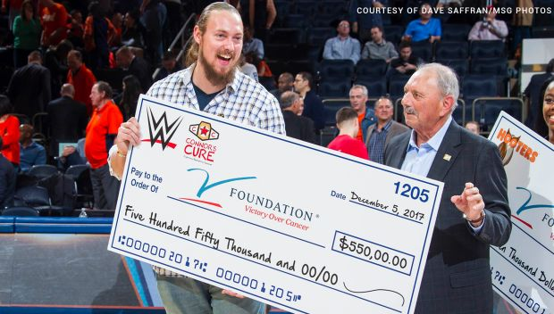 Big Cass presents a check to the V Foundation at the Jimmy V Classic: photos