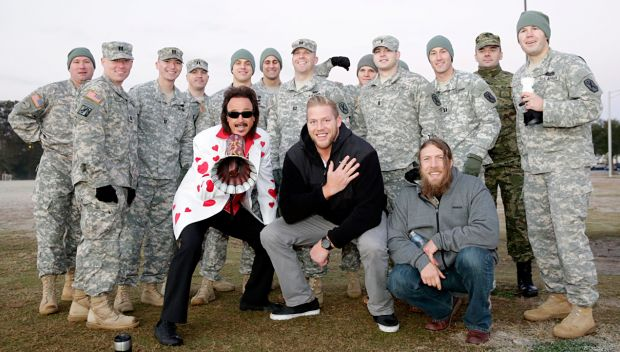 WWE Superstars & Legends encourage soldiers during an Iron Mike competition: photos