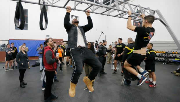 WWE Superstars observe and participate in morning workouts with servicemembers at Fort Hood: photos