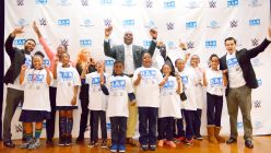 WWE Superstar Titus O'Neil greets the 300 students, ages 5 to 10.