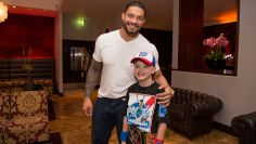 Roman Reigns poses for a photo with his new friend Tommie, 8, from Rays of Sunshine.