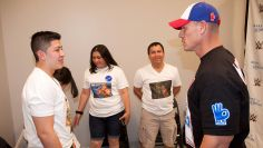 John Cena meets Kenny, 17, from Make-A-Wish before WWE Money in the Bank in Las Vegas.