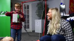 Charlotte Flair and Cricket Cares surprise a deserving military family with gifts and smiles