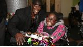 R-Truth meets an excited young fan at St. Mary's Hospital for Children in Bayside, Queens.