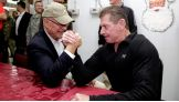 While visiting U.S. troops in the Middle East, WWE Chairman and CEO Vince McMahon is challenged by Senator Pat Roberts from Kansas.