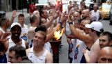 The Special Olympics Flame of Hope makes its way through New York City.