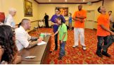 Randy Orton, Sheamus and Alicia Fox greet 25 Make-A-Wish families for a private signing during WrestleMania Week.