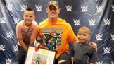 John Cena meets Spencer before Raw in Tampa, Fla.