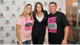 Chief Brand Officer Stephanie McMahon and WWE Superstars and Divas meet breast cancer survivors and Susan G. Komen honorees before Raw in Boston.