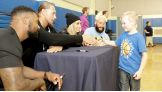 NXT Superstars Kenneth Crawford, Colin Cassady, Carmella and Enzo Amore greet young fans.