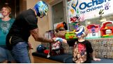 Rey Mysterio greets a member of the WWE Universe at Ochsner Medical Center in New Orleans.