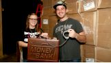 James and Ashlee get up close to the Money in the Bank briefcase.