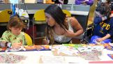 Ember Moon enthusiastically joins children in activities during the hospital visit.