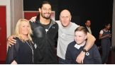 Roman Reigns grants three wishes during WWE's visit to Manchester, England.