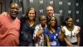 The 14-year-old and his family pose with Stephanie McMahon and Triple H.