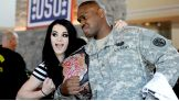 WWE Divas Champion Paige meets a member of the U.S. Army at USO Warrior and Family Center.