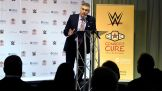 The announcement is made at Children's Hospital of Pittsburgh, where Connor's Cure was originally established. Representatives from the hospital, including Greg Barrett, President of CHP Foundation, WWE and The V Foundation, announce the partnership.