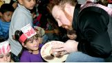 Along with Malchiodi, Sheamus leads a mask-making activity with the kids.