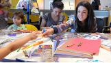 Raw Women's Champion Bayley is happy to join the children doing activities.