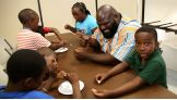 Mark Henry gets in the middle of craft-making with the young fans.