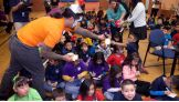 The Usos help the students participate in the craft-making project.