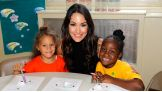 Brie poses with two of the youngsters at the event.
