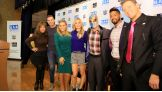 Robin Bronk, CEO of The Creative Coalition, poses with Sharif, Natalya, Renee Young, Sin Cara, Darren Young and The Miz after the rally.