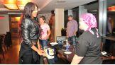 Alicia Fox talks to a breast cancer survivor before Raw.