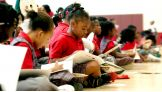 """At the end of the event, the kids have their books autographed and receive """"WWE Reading Superstar"""" titles."""