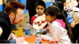 The Superstars participate in a craft-making project with the children.