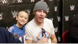 Dean Ambrose poses for a photo with a young fan.