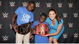 Stephanie McMahon presents Jarrius with a Hero Award.