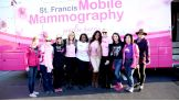 The Divas pose with Komen staff and guests at the St. Francis Mobile Mammography Coach.