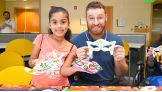 Sami Zayn shows off his crafty creation during the hospital visit.