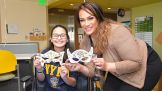 Nia Jax creates a mask with a fan at Orlando's Florida Hospital for Children.