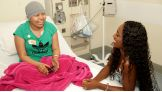 Naomi talks to a young patient at Children's Hospital Los Angeles.