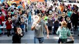 The Superstars and children make masks to wear in the plaza.