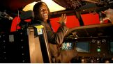 R-Truth sits in the pilot's chair of the MH-60 simulator.
