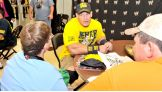 Cena signed autographs and posed for pictures, helping to bring smiles to the children's faces.