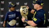 WWE Champion John Cena shows his title to Jonathan.